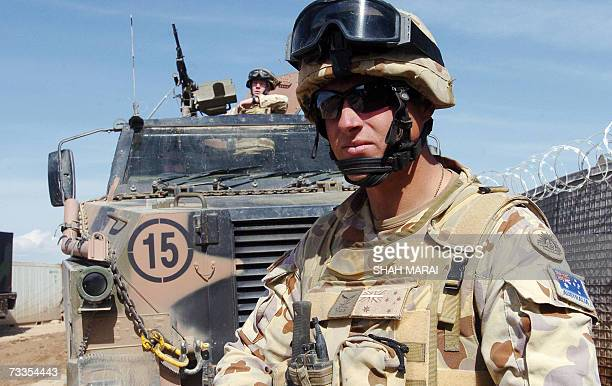 Australian soldiers of the NATOled International Security Assistance Force stand guard at the Provincial Reconstruction Team in Tirin Kot the capital...