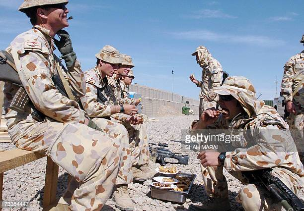 Australian soldiers of the NATOled International Security Assistance Force have lunch at their base in Tirin Kot the capital of Uruzgan province 17...