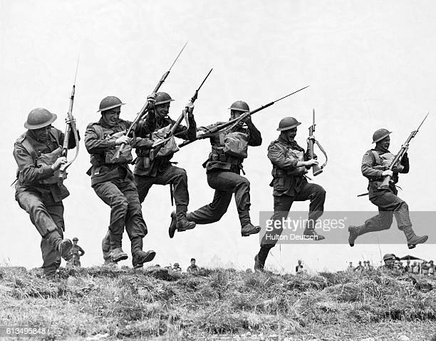 Australian soldiers practice their bayonet charge at their training camp in England during World War II 1940