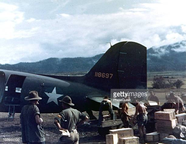 Australian solidiers help US troops unload a C47 transport plane New Guinea Australian soldier stationed at Wau New Guinea April 27 1943 The...