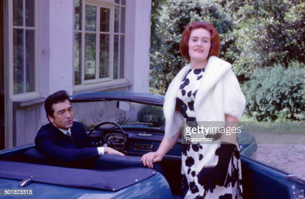Australian soprano opera singer Joan Sutherland pictured with her husband conductor Richard Bonynge sitting in a car outside their home in 1962