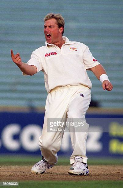 Australian spin bowler Shane Warne celebrates the wicket of New Zealand batsman Nathan Astle for 35 to equal Dennis Lillee's Australian record of 355...