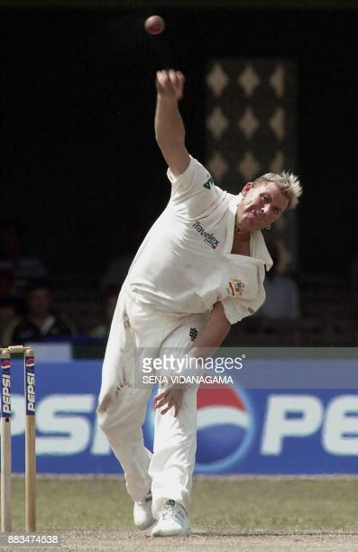 Australian spin bowler Shane Warne delivers a ball against Pakistan during the third day of the first cricket Test match between Australia and...