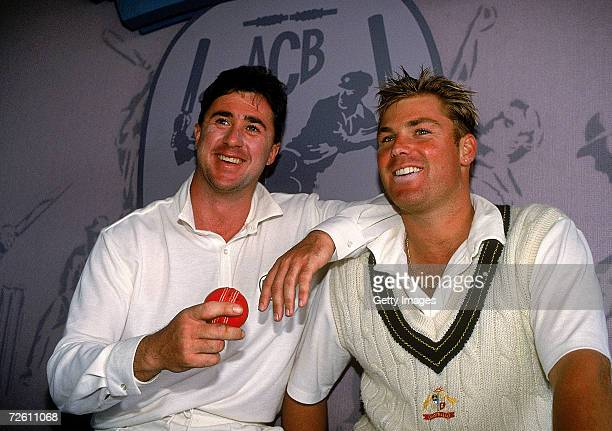 Australian spin bowlers Tim May and Shane Warne pose for a photo after Australia's win in the 2nd Test match between Australia and New Zealand at...