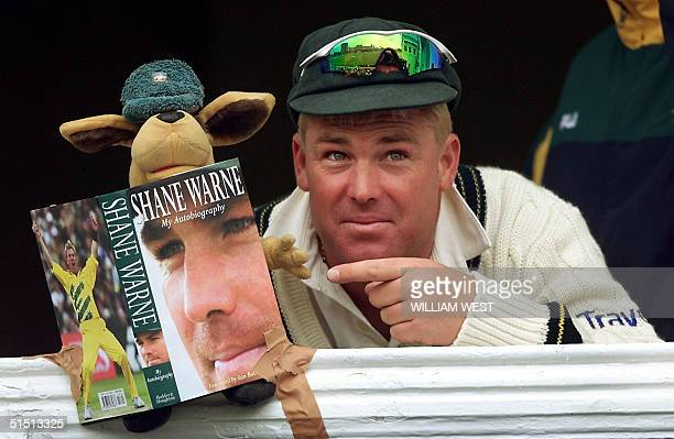 Australian spinner Shane Warne is all smiles as teammates arrange for the team mascot to appear to be reading Warne's autobiography on the third day...