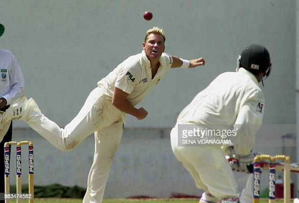 Australian spring bowler Shane Warne delivers a ball against Pakistani batsman Rashid Latif during the third day of the first cricket test match...