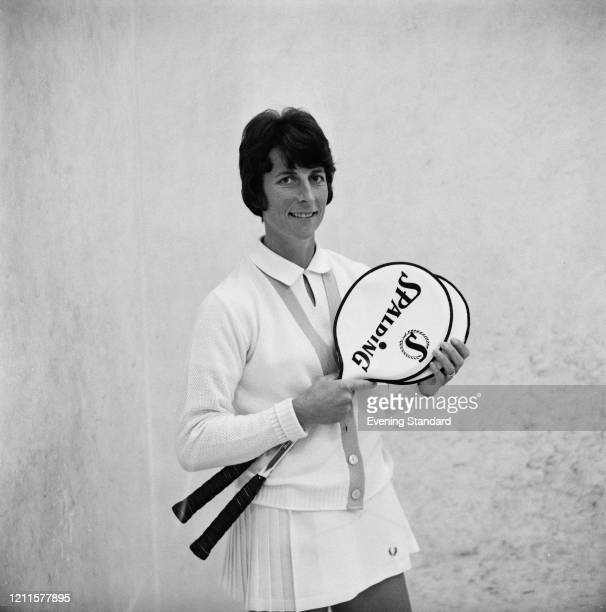 Australian squash player Heather McKay posed with her Spalding squash rackets on court on 28th January 1971