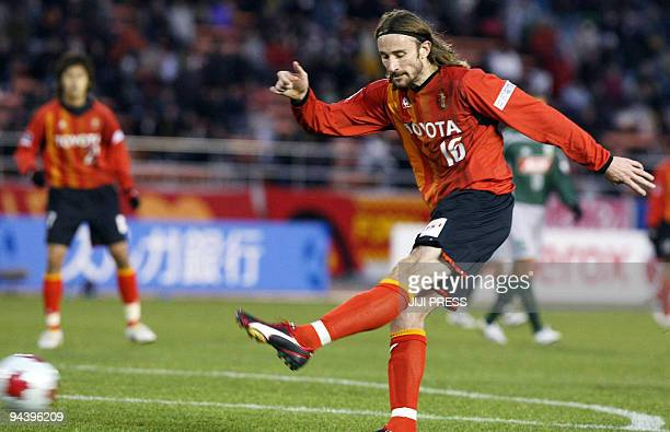 Australian striker Josh Kennedy of Nagoya Grampus kicks to score a goal one of three to make a hattrick against FC Gifu during their quarterfinal...