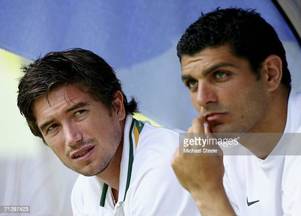 Australian substitutes Harry Kewell and John Aloisi look on during the FIFA World Cup Germany 2006 Round of 16 match between Italy and Australia at...