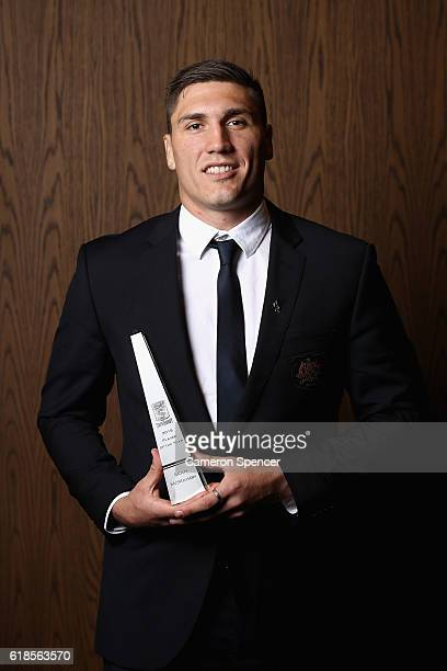 Australian Super Rugby Player of the Year Sean McMahon poses with his award during the 2016 John Eales Medal at Royal Randwick Racecourse on October...