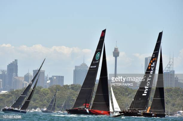 Australian Supermaxi yacht Comanche sails through Sydney Harbour at the start of the Sydney to Hobart yacht race on December 26 2018 / IMAGE...