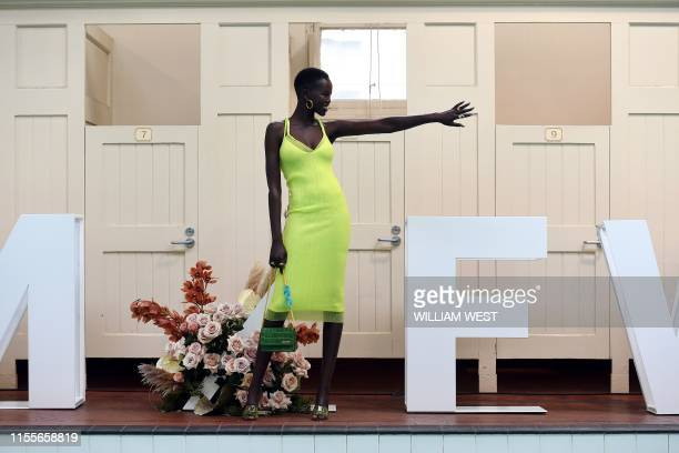 Australian supermodel Adut Akech poses for photos at the Melbourne City Baths after it was announced Akech would be the Melbourne Fashion Week 2019...