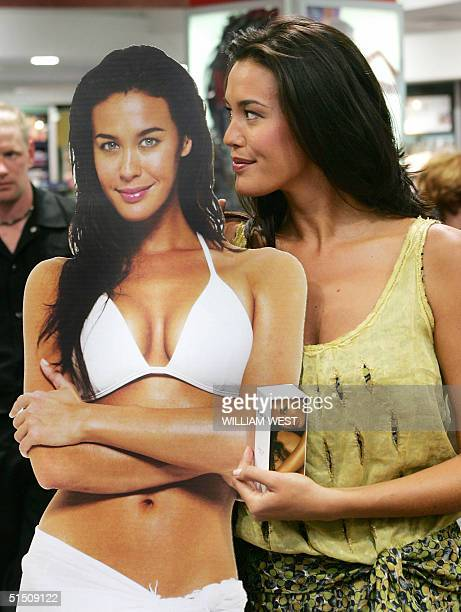 Australian supermodel Megan Gale inspects a cutout of herself during an instore appearance in Melbourne 20 October 2004 Gale is making her only...