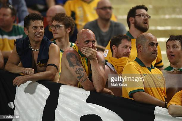 Australian supporters in the crowd look dejected during the 2018 FIFA World Cup Qualifier match between Thailand and the Australia Socceroos at...