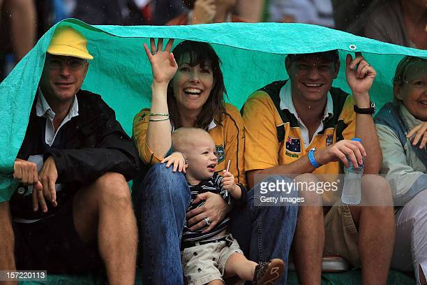 Australian supporters sheltering from the heavy rain in the desert during the Emirates Airline Dubai Rugby Sevens on November 30 2012 in Dubai United...