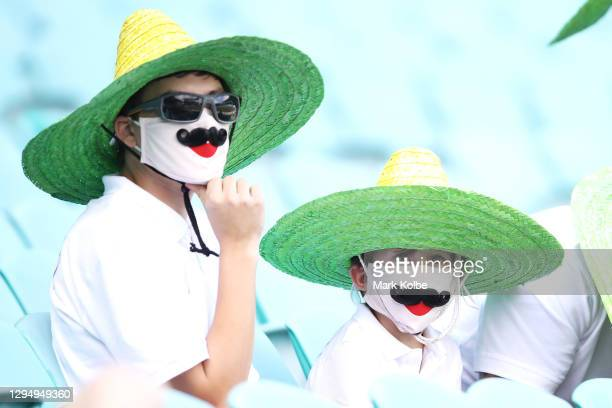 Australian supporters wearing protective masks are seen in the crowd before play during day one of the Third Test match in the series between...
