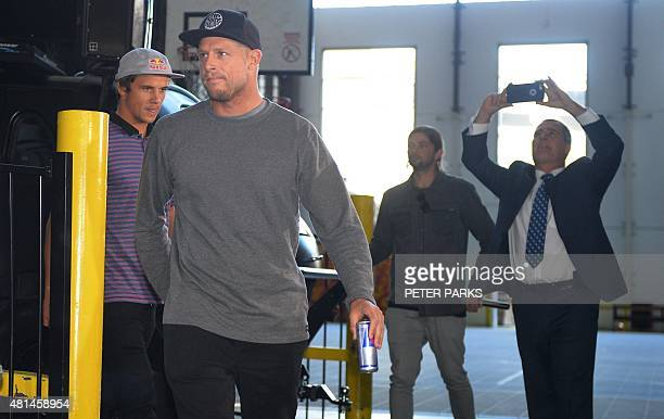 Australian surf champion Mick Fanning and his friend Julian Wilson arrive at a press conference held in Sydney after they flew in from South Africa...