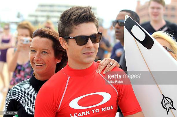 Australian Surf Legend Layne Beachley and Zac Efron pose for a photo at the Oakley's 'Learn To Ride' charity learntosurf event in aid of the One...