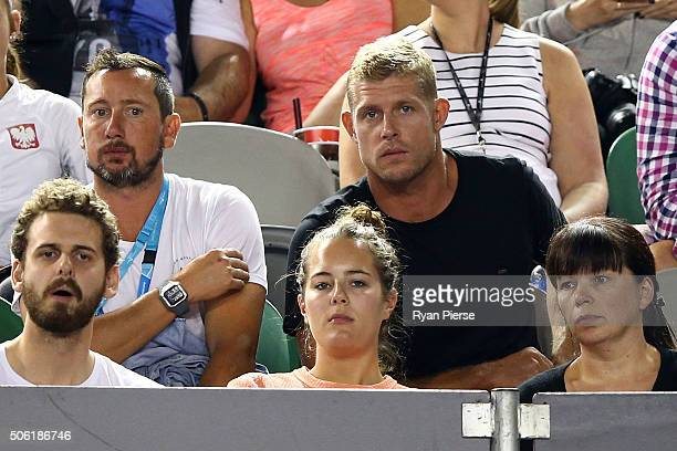 Australian surfer Mick Fanning watches the third round match between Roger Federer of Switzerland and Grigor Dimitrov of Bulgaria during day five of...