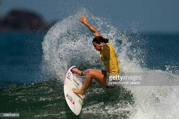 Australian surfer Tyler Wright competes to win the final the final of ASP world tour Billabong Girls Rio Pro 2013 at Barra de Tijuca beach in Rio de...
