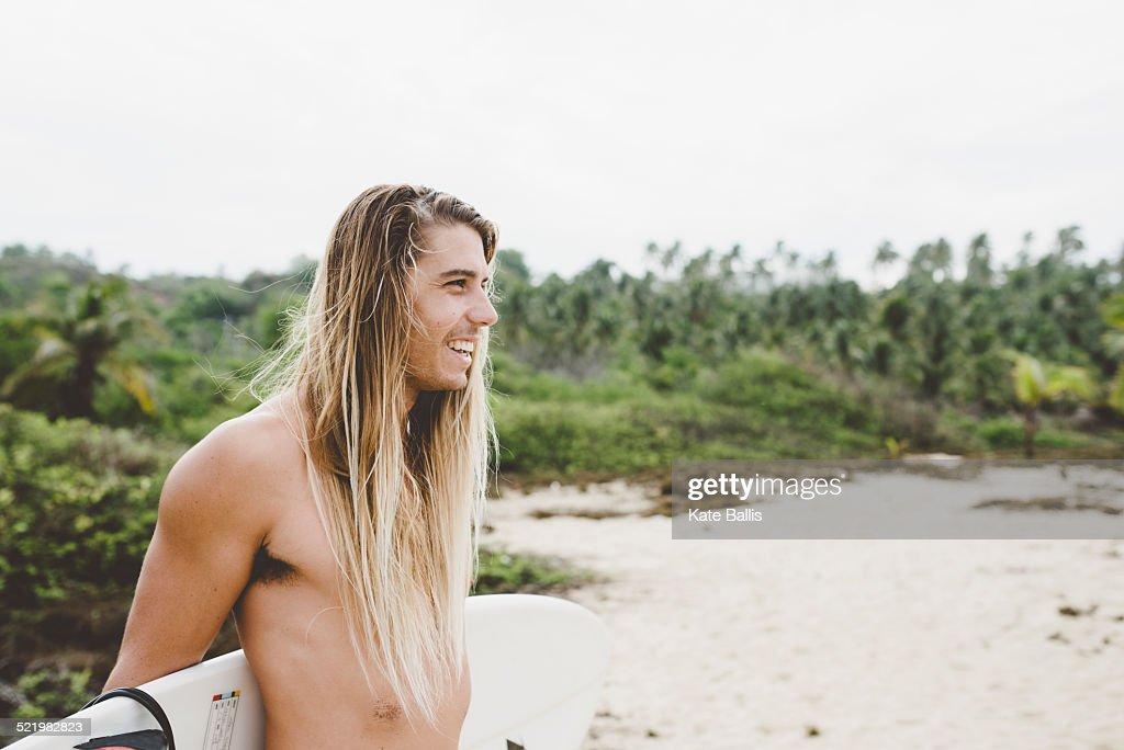 Australian surfer with surfboard, Bacocho, Puerto Escondido, Mexico : Stock Photo