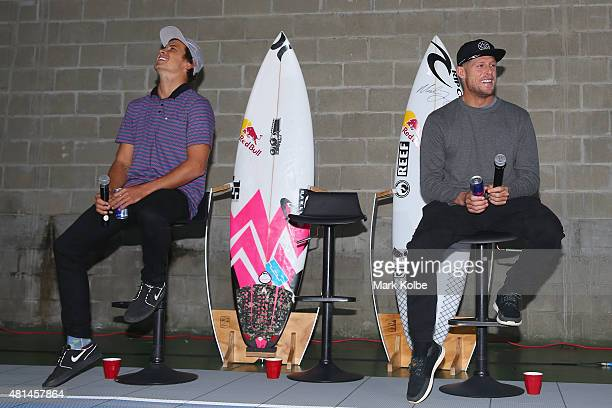 Australian surfers Julian Wilson and Mick Fanning share a laugh as they speak to the media during a press conference at All Sorts Sports Factory on...
