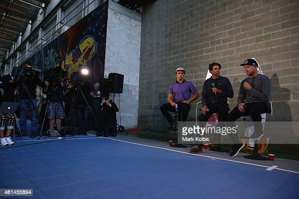 Australian surfers Julian Wilson and Mick Fanning speak to the media during a press conference at All Sorts Sports Factory on July 21 2015 in Sydney...
