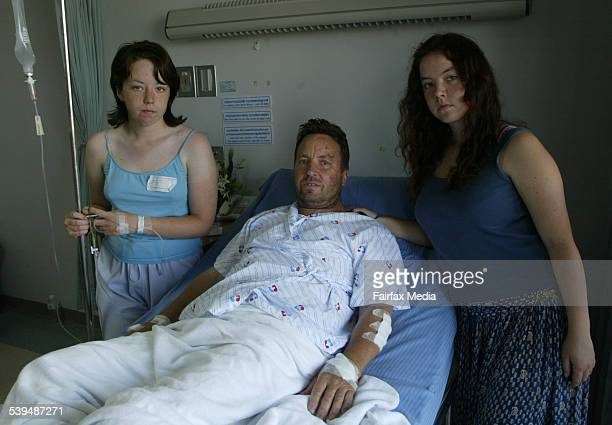 Australian survivers Chris Fryer and two daughters Michelle and Louise 18 in a Phuket hospital waiting for news on missing wife and mother Dinah 29...
