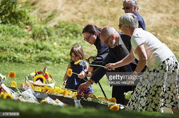 Australian survivor Gill Hicks and her daughter lay flowers at the 7/7 memorial in London's Hyde Park on July 7 in memory of the 52 people killed...