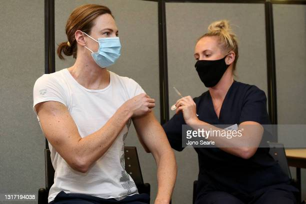 Australian swimmer Cate Campbell has her vaccination against Covid-19 during a media opportunity at the Queensland sports and Athletics center, on...