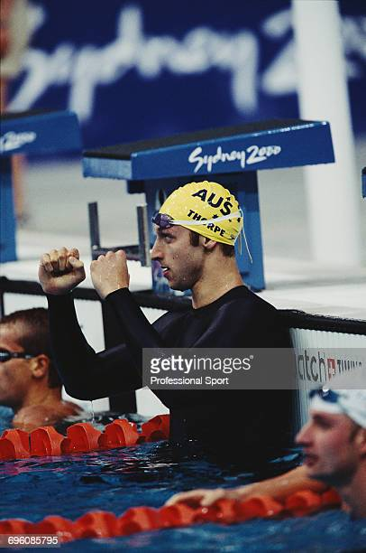 Australian swimmer Ian Thorpe celebrates after finishing in first place in a world record time to win the gold medal for Australia in the Men's 400...