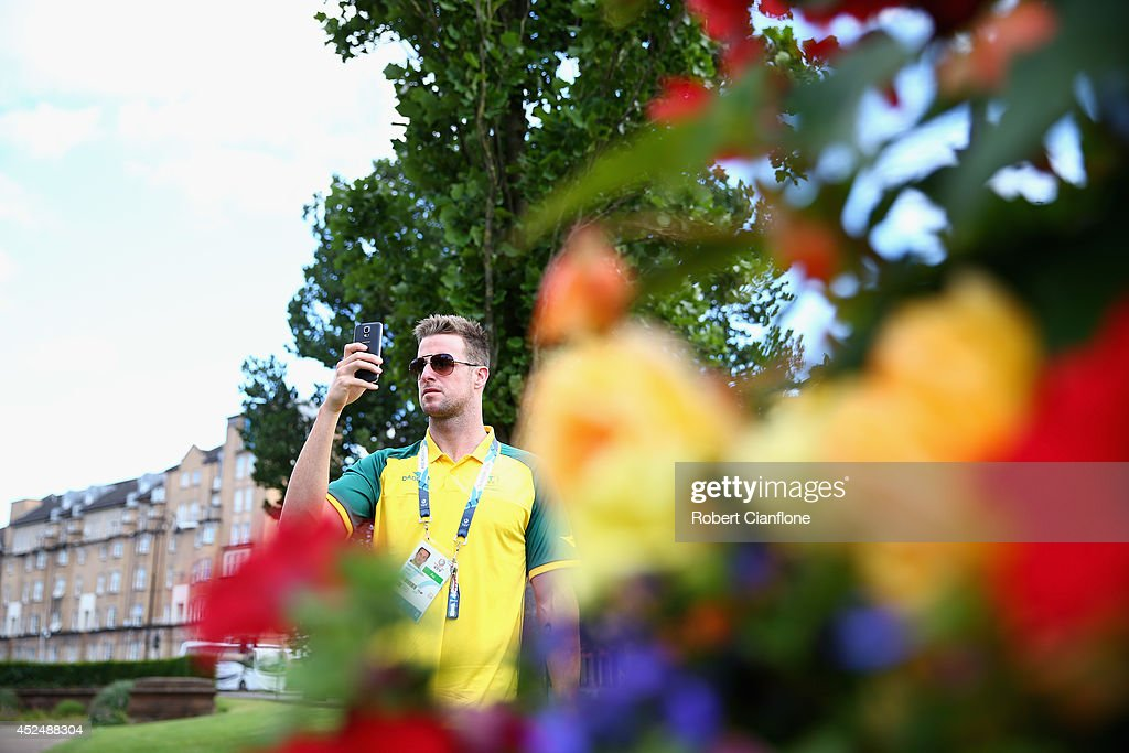 Australian swimmer James Magnussen takes a photo on his phone during the Australian Commonwealth Games official team reception at the Kelvin Grove Art Gallery and Museum on July 21, 2014 in Glasgow, Scotland.