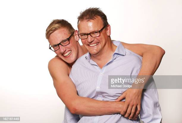 Australian swimmer Mack Horton poses with his father Andrew Horton during a portrait session at Melbourne Sports and Aquatic Centre on February 19...