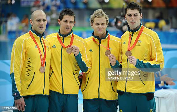 Australian swimmers Ashley Callus Eamon Sullivan Andrew Lauterstein and Matt Targett pose with their bronze medals after the men's 4X100m freestyle...
