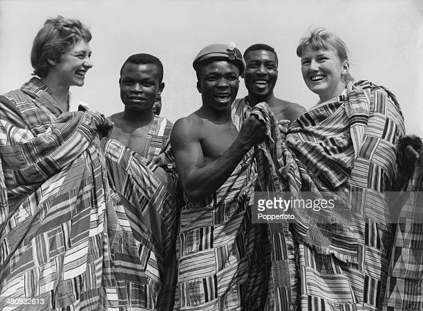 Australian swimmers Beverley Bainbridge and Lorraine Crapp try on the robes of Ghanaian athletes including featherweight boxer Floyd Robertson at the...