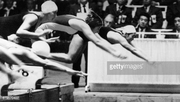 Australian swimming champion Dawn Fraser dives for the victory in the women's 100m free style clocking the first ever 100m woman time record under...