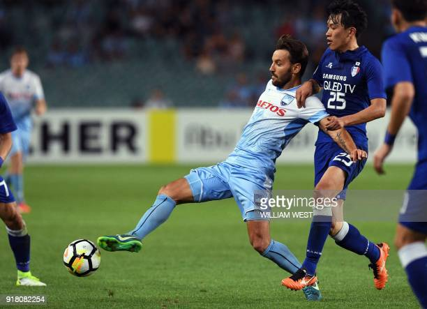 Australian Sydney FC player Milos Ninkovic is tackled by South Korea's Suwon Bluewings Choi Sungkeun during their AFC Champions League football match...