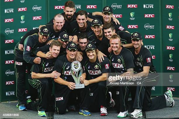 Australian team pose with the trophy after winning the game three of the Men's International Twenty20 series between Australia and South Africa at...