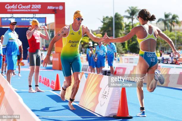 Australian team relay members Jacob Birtwhistle and Ashleigh Gentle change over during the Mixed Team relay during the Triathlon on day three of the...
