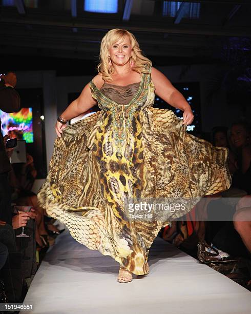 Australian television personality Ajay Rochester walks the runway during the Real Fashion Real Women Runway Show Benefiting Bottomless Closetat...