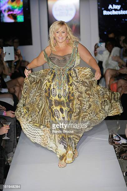Australian television personality Ajay Rochester walks the runway during the Derek Warburton Real Fashion Real Women Benefit during Spring 2013...