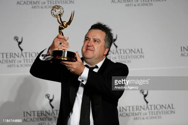 Australian television producer Stephen Corvini holds the International Emmy for 'Safe Harbour' in the category of TV Movie/MiniSeries at the 47th...
