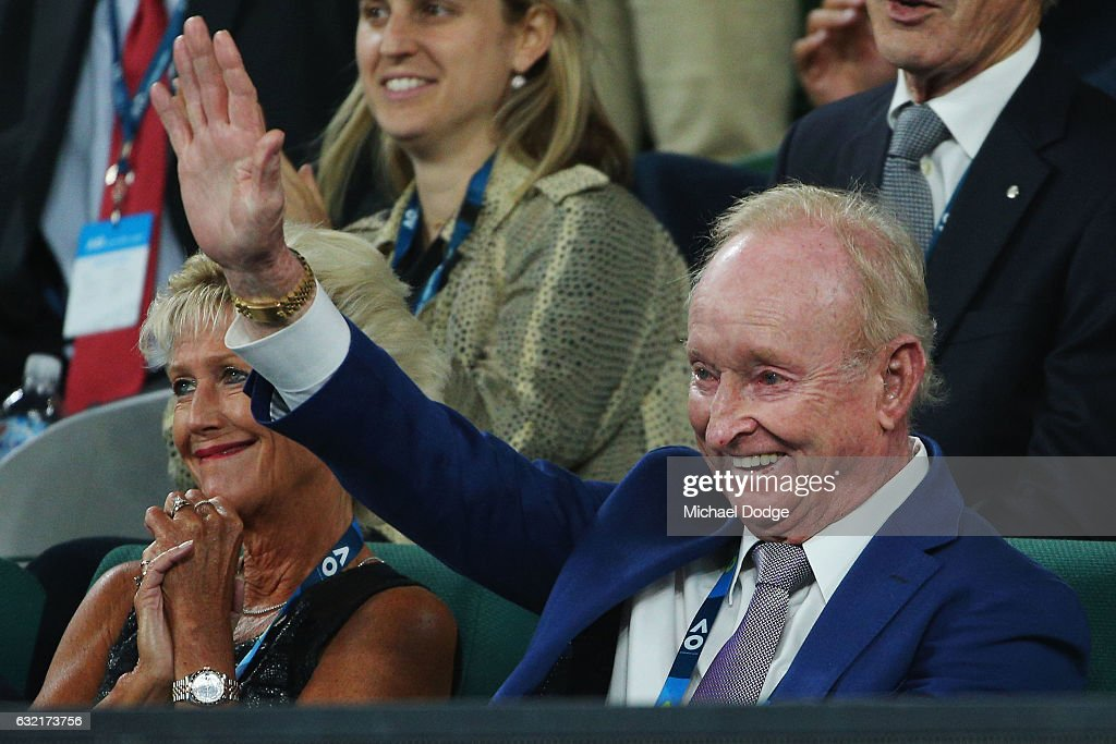 Australian Tenis legend Rod Laver waves to Roger Federer of Swizterland after his win against Tomas Berdych (L) of the Czech Republic walks on on day five of the 2017 Australian Open at Melbourne Park on January 20, 2017 in Melbourne, Australia.