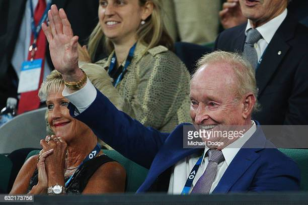 Australian Tenis legend Rod Laver waves to Roger Federer of Swizterland after his win against Tomas Berdych of the Czech Republic walks on on day...