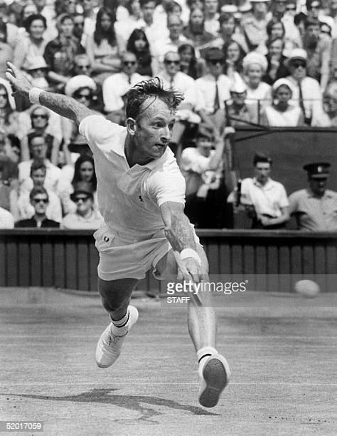 Australian tennis champion Rod Laver returns the ball 07 July 1968 during the Wimbledon International tournament single men's final against his...