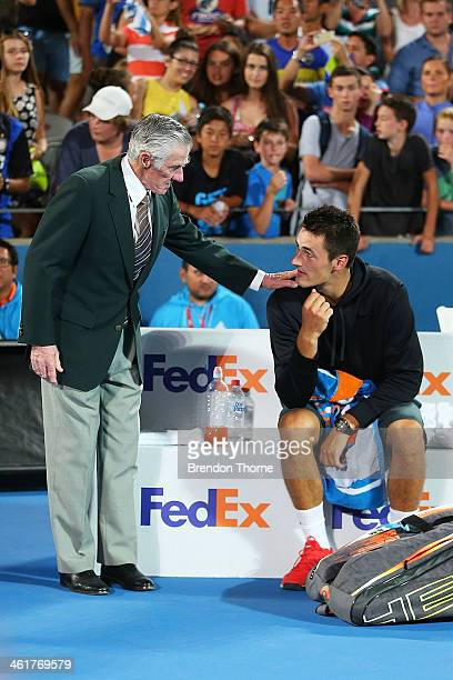 Australian tennis legend Ken Rosewall comforts Bernard Tomic of Australia after losing the mens singles final to Juan Martin Del Potro of Argentina...
