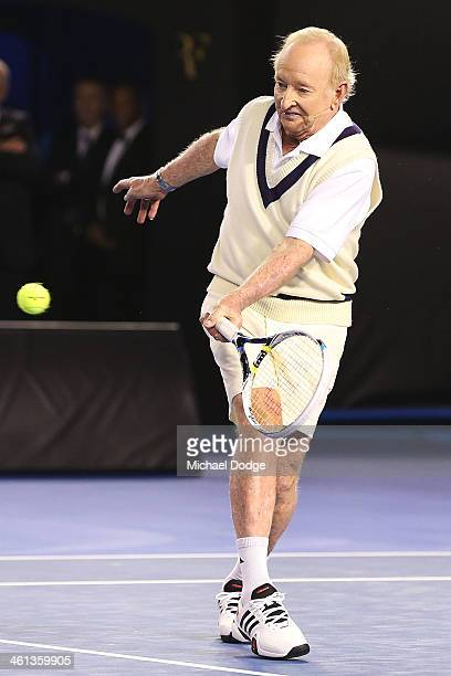 Australian tennis legend Rod Laver hits a forehand when hitting with Roger Federer of Switzerland during the Roger Federer Charity Match at Melbourne...