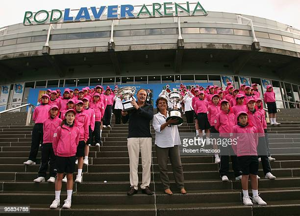 Australian tennis legends John Newcombe and Evonne Goolagong Cawley pose with the Daphne Akhurst Memorial Cup and the Norman Brookes Challenge Cup...