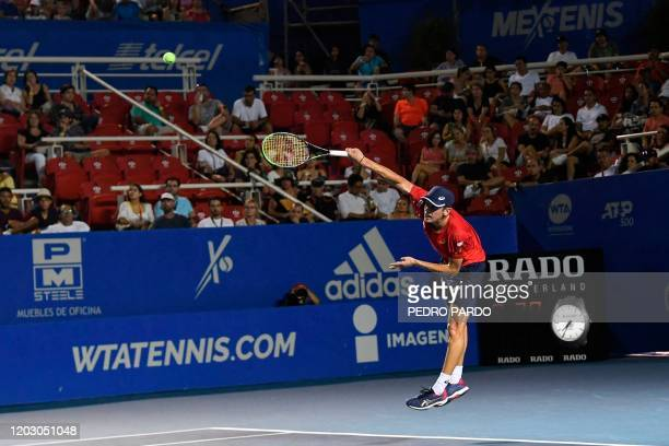 Australian tennis player Alex de Minaur serves to Serbia's player Miomir Kecmanovic during their Mexico ATP Open 500 men's singles tennis match in...