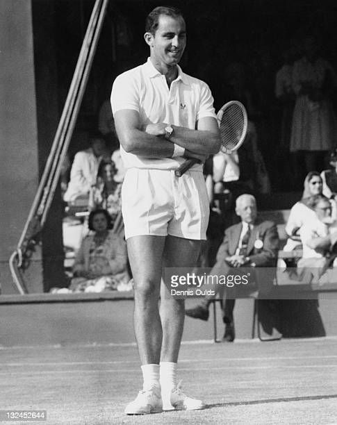 Australian tennis player Bob Hewitt standing with arms folded after a doubtful line decision during his Men's Singles third round match against Bobby...